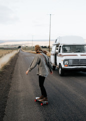 Girl skating in open road