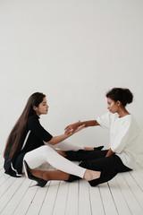 Portrait of two women in white studio