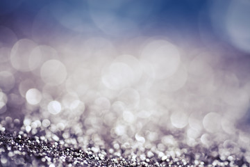 abstract Christmas background with holiday lights and copy space - magic bokeh glitter with...