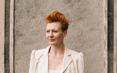 Portrait of a attractive woman of fifty years with red hair