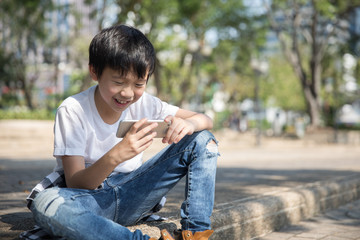 Young boy watching videos on his phone
