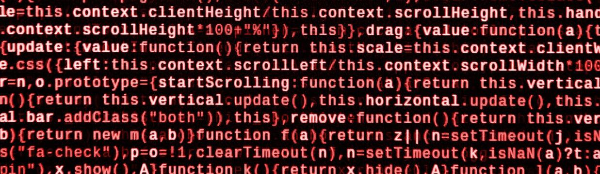 Writing programming code on laptop. Digital binary data on computer screen