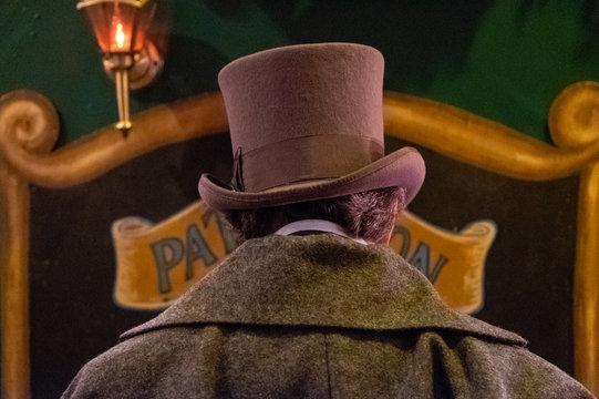 man in top hat walking away