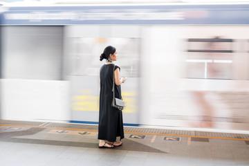 Woman Waiting on Railway Station