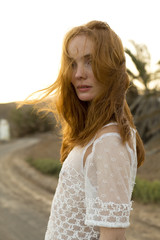 young woman with red hair and white blouse