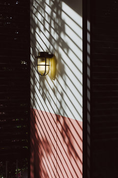 Brass Lamp on Wall with Blinds
