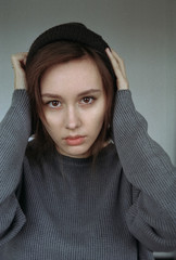 Portrait of woman holding head