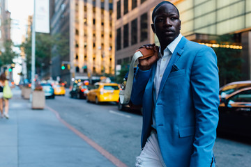 Young businessman walking in the street in New York City