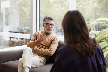 Businessman Discussing With Female Colleague