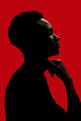 African American man portrait profile silhouette isolated over red - touching the neck