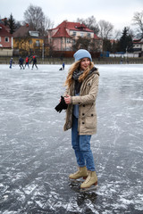 Woman putting on gloves on rink