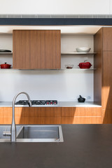 Contemporary kitchen with black  dekton stone benchtop