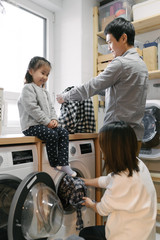 Asian family dong laundry at home