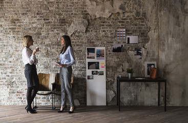 Businesswomen in a modern creative studio
