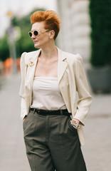 attractive senior woman walking on the street