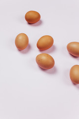 Eggs on pink background