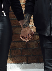 Young Couple Hand in Hand . Close up