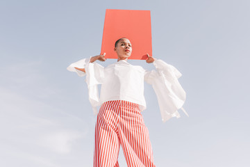 girl with red board