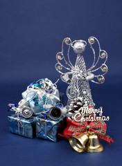 Merry Christmas with gift box and decoration with blue backdrop.