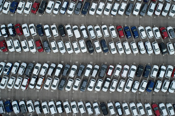Rows of car filling parking lots