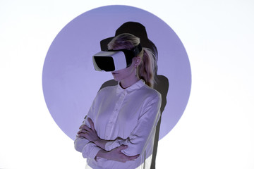 Portrait of woman with VR set