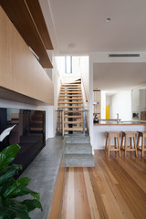 Modern conversion in loft apartment with timber stairs leading t