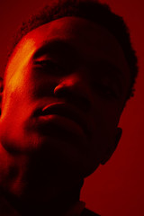 African American man portrait under red lights