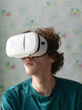 Man lounging in VR goggles