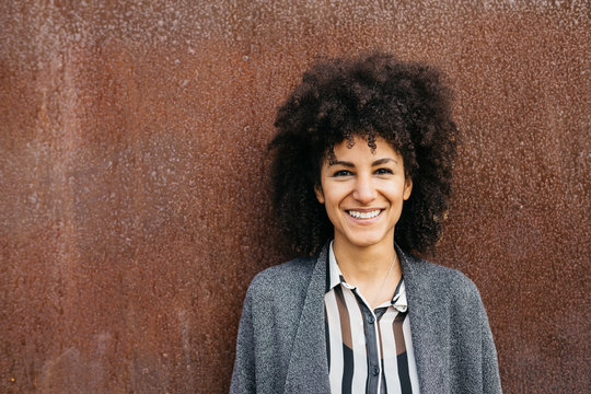 Funny woman with afro hairstyle.