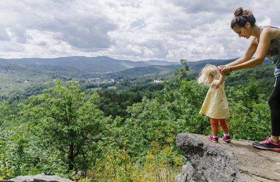 Little Girl at Summit of Mountain