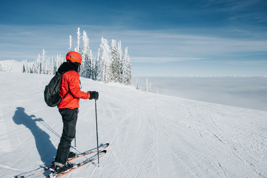 Downhill skier on top of the mountain taking in the views.