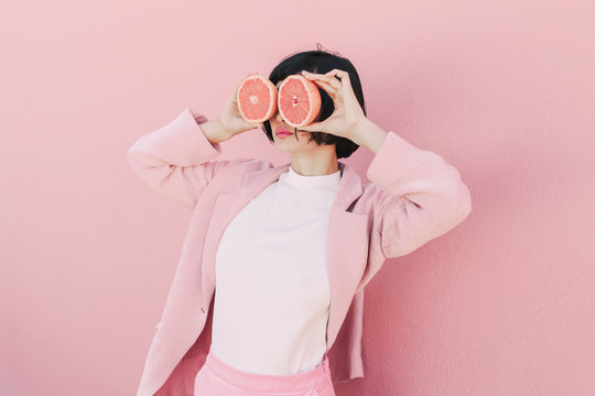 Girl in pink with grapefruit