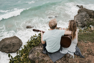 Couple on the cliff with ocean view