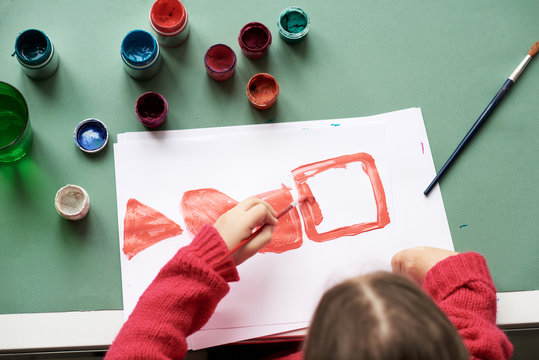 Amputee kid painting picture