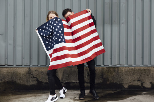 Young Couple with an US Flag