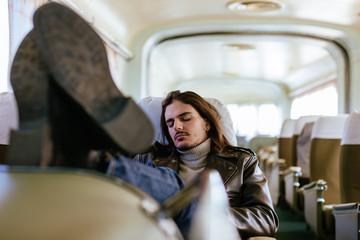 Man sleeping in train.