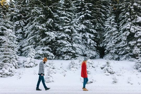 Couple Walking in Snowy Mountain