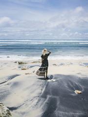 Woman on tropical coastline of ocean
