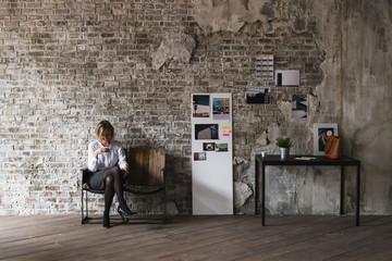 Businesswoman in a modern creative studio