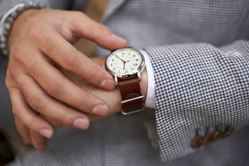 Stylish man checking the time on his watch