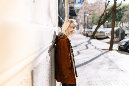 Young casual girl on light street