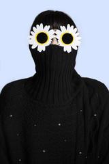 Woman wearing daisy sunglasses