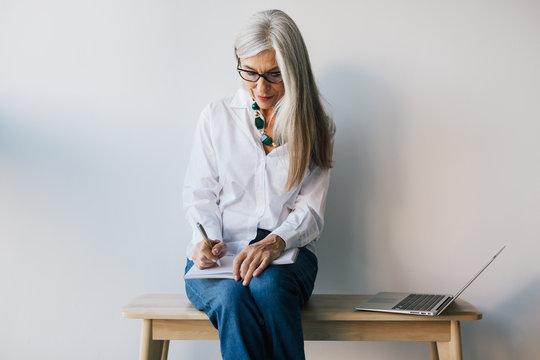 Senior businesswoman working at office.