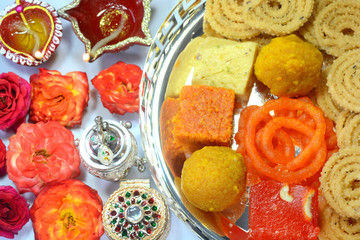 Diwali Sweets and Snacks with flowers and lights decorated for Diwali festival
