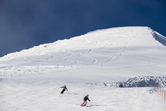 Skiers on slope in ski field