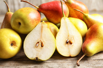 Ripe pears on wooden table. Healthy snack