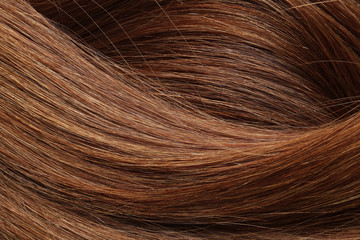 Texture of healthy red hair as background, closeup