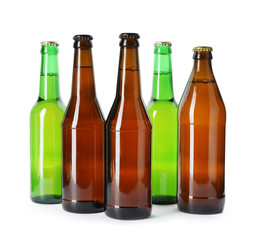 Bottles with different alcoholic drinks on white background