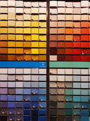Colorful paint swatches ordered from light to dark, and in color categories, at the hardware store