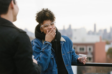 Young woman laughing at party